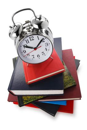 Clock on pile of books
