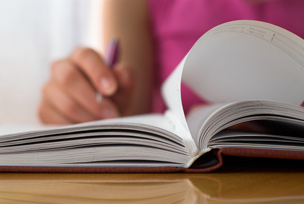 Person studying with a book