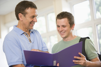 Teacher offering feedback to pupil